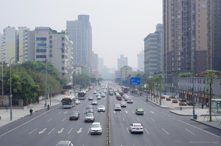 A view road with light traffic in Chengdu during the day - there is both humidity and smog in the air