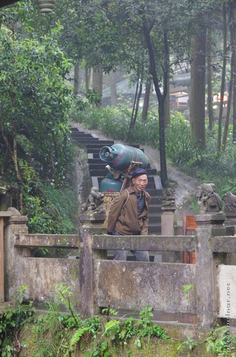 Local in Qingcheng with 2 huge gas tanks in his back