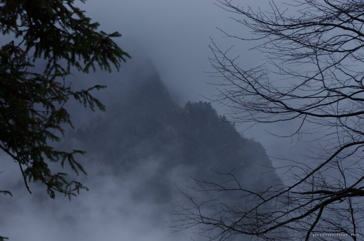 Peaks can sometimes be spotted out of the fog and the clouds at Mount Emei