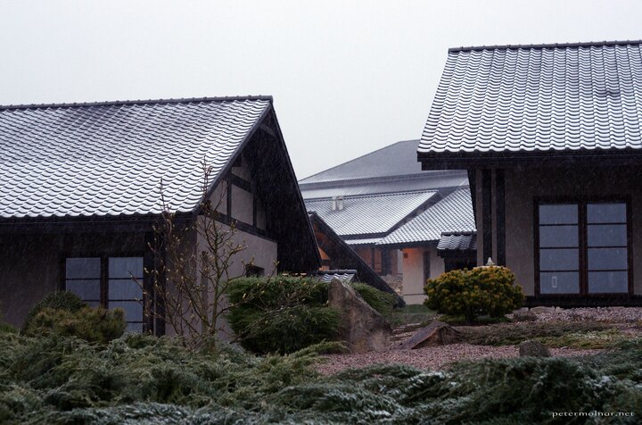 Snowy rooftops of the living accommodations at Dojo Stara Wies