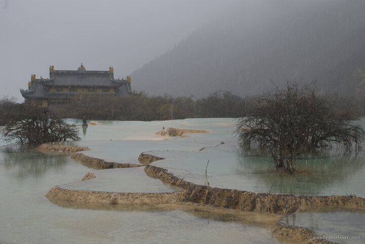 Ancient temple in Huanglong with pond